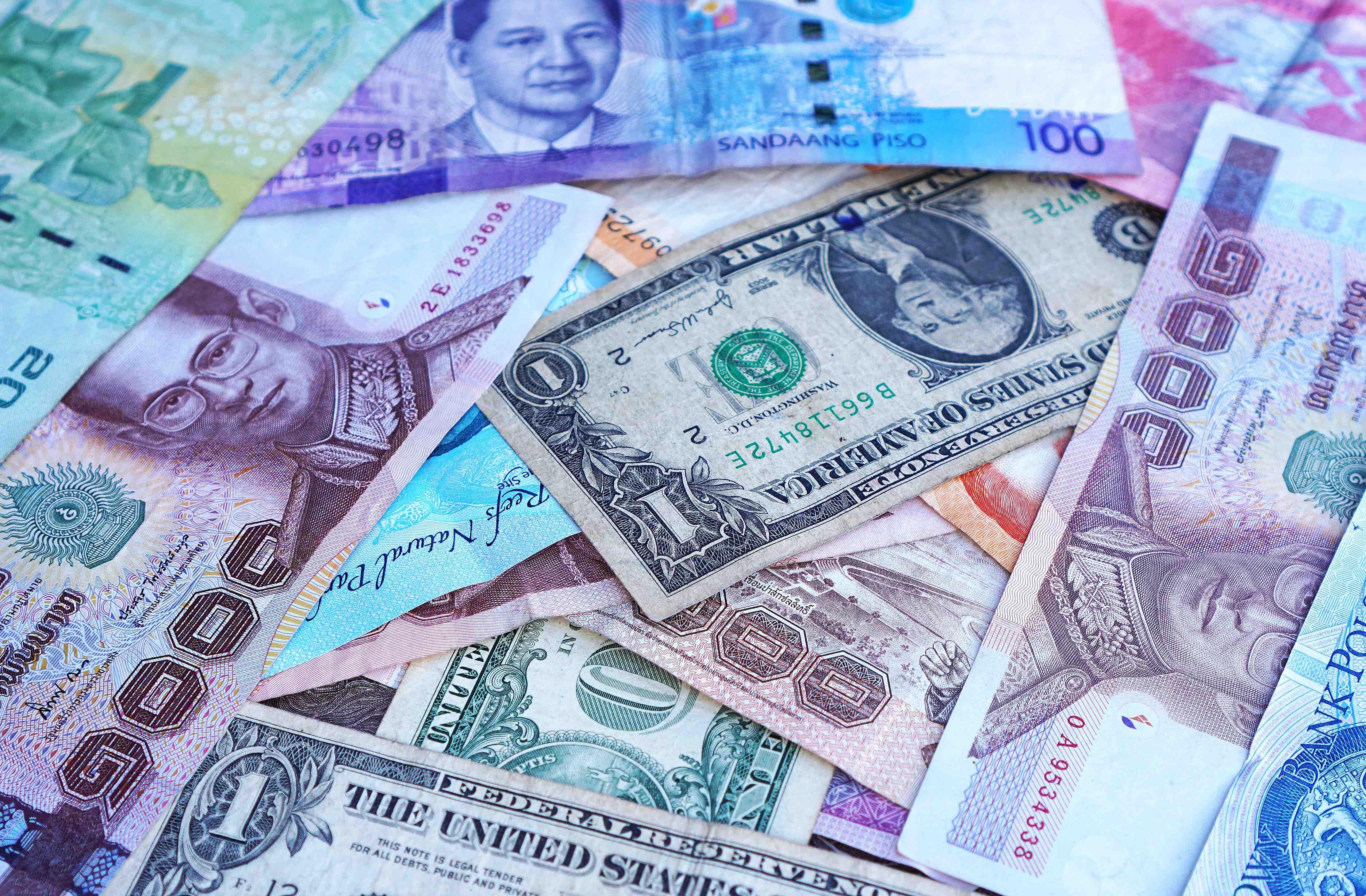 Vreemde valuta hier opnemen of pas in het buitenland?